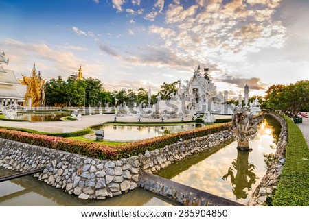 Thailand temple or grand white church Call Wat Rong Khun,at Chiang Rai province, Thailand,Contemporary unconventional Buddhist temple.  - stock photo