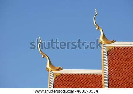 Thailand temple roof with gable apex on the top and blue sky background