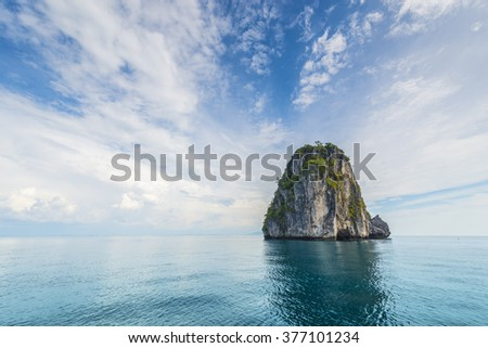 Thailand tropical island cliffs over ocean water during tourist boat trip in Railay Beach resort