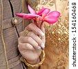Thailand wedding dress holding flowers. - stock photo