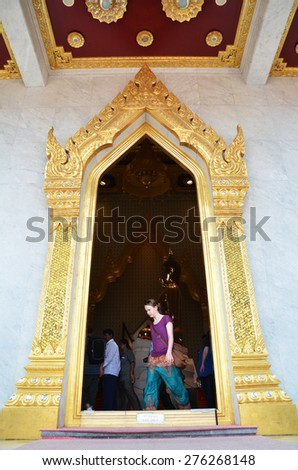 THAILNAD, BANGKOK - MAR 29: People visit Wat Traimit in Bangkok Chinatown on March 29, 2015 in Bangkok, Thailand. The Buddhist temple is one of the most sacred sites in the Thai capital. - stock photo