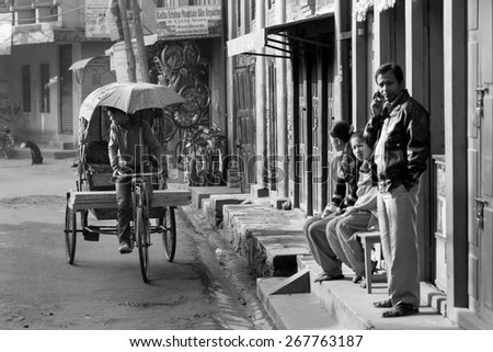 THAMEL, KATHMANDU, NEPAL - NOVEMBER 20, 2014: Rickshaws driving by the street of Kathmandu, Nepal on November 20. Rickshaws are the means of transport with the lowest cost in Kathmandu.
