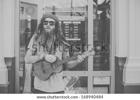 THAMES, NEW ZEALAND - AUGUST 17: Musician at the Thames Market Day on August 17, 2013. - stock photo