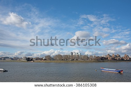 Thames river and Canary Wharf skyline from Greenwich with dramatic skyscape.  - stock photo