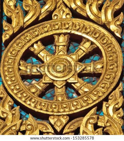 Thammachak rowel Symbols of Buddhism. - stock photo