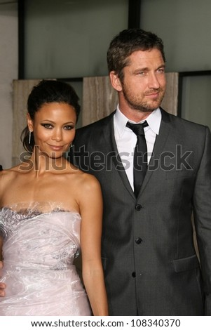 Thandie Newton and Gerard Butler  at the Los Angeles Premiere of 'Rocknrolla'. Pacific Cinerama Dome, Hollywood, CA. 10-06-08 - stock photo