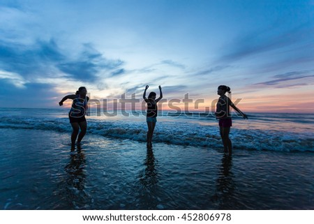 Thanh Hoa, Vietnam , Aug 13 2015 , group of friends splashing water in the sea at samson beach, Thanh Hoa. people and fun