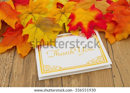 Thank You, Autumn Leaves on weathered grunge wood with a Thank You Card