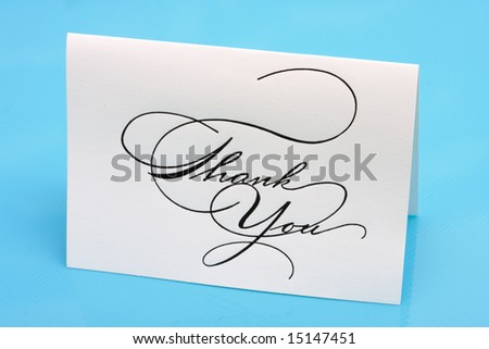 Thank you card on a blue background - stock photo