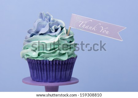 Thank you cupcake on blue background - stock photo