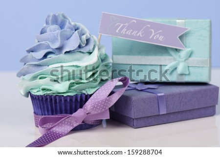 Thank you cupcake with presents and bow - stock photo