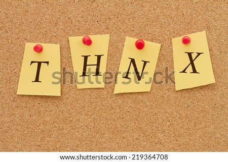 Thank you, Four yellow notes on a cork board with the word THNX - stock photo