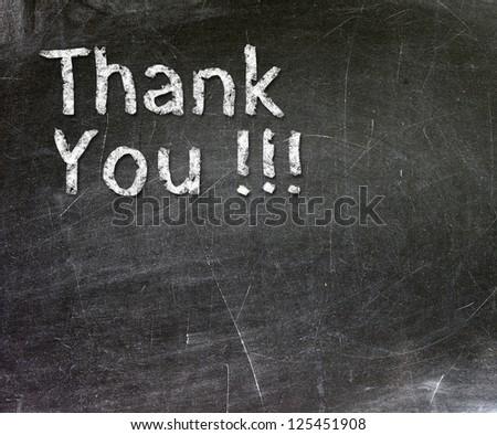 Thank You handwritten with white chalk on a blackboard. - stock photo