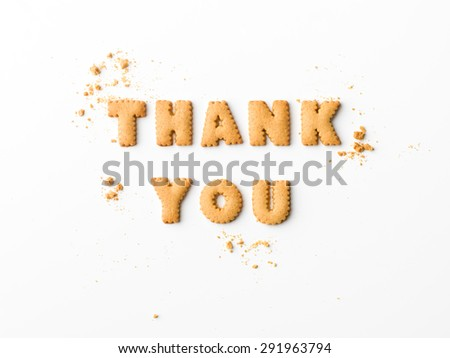 thank you message written with letter biscuits, on white background - stock photo