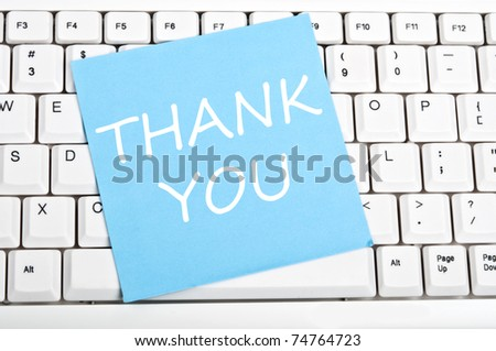 Thank you note on an white keyboard - stock photo