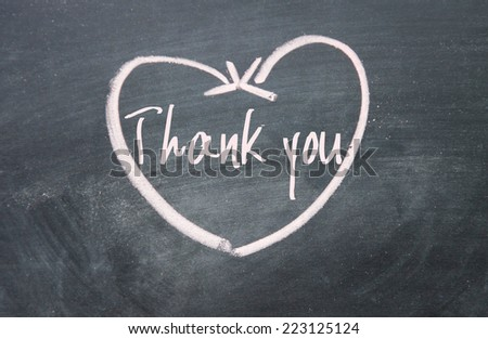 thank you text and heart sign on blackboard - stock photo