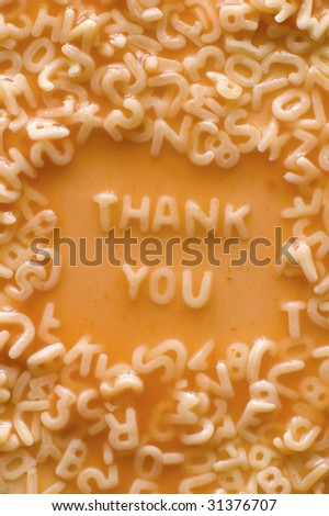 THANK YOU text made of pasta letters, ketchup tomato soup - stock photo