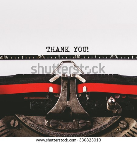Thank you text on old typewriter, retro toned conceptual image - stock photo