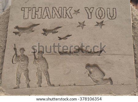 Thank You to Our Troops and Military Service Men and Women Carved in Sand - stock photo