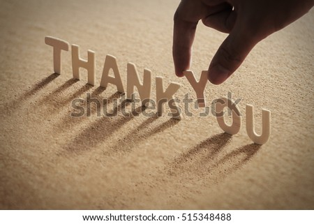 THANK YOU word of wood alphabet with shadow on cork board,compressed board
