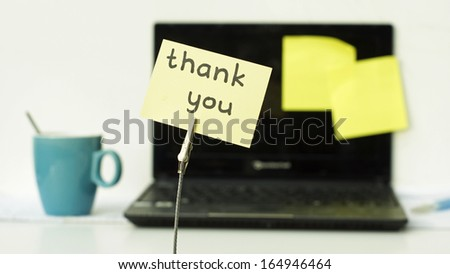Thank you written on a memo at the office - stock photo