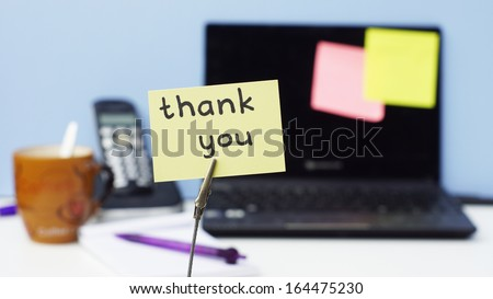 Thank you written on a memo in a office - stock photo