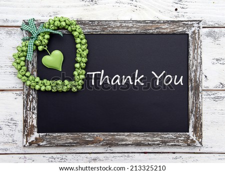 Thank you written on chalkboard, close-up - stock photo