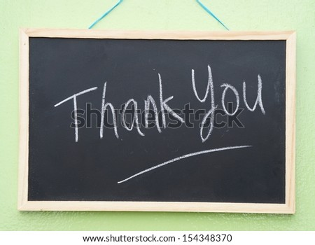 Thank you written with chalk - stock photo