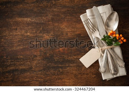 Thanksgiving autumn place setting with cutlery - stock photo