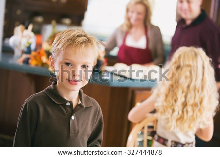 Thanksgiving: Boy Waits While Dinner Is Prepared - stock photo