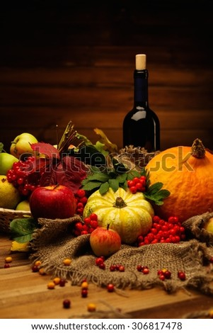 Thanksgiving day autumnal still life with bottle of wine  - stock photo