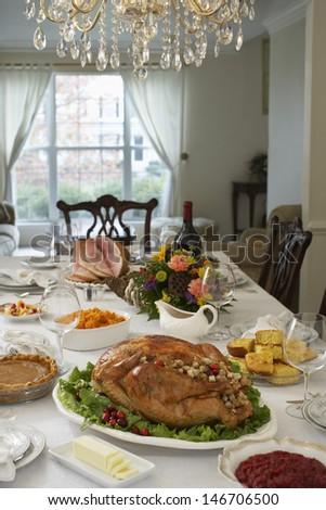 Thanksgiving dinner on table in elegant home - stock photo