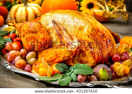 Thanksgiving dinner. Roasted turkey on holiday table with pumpkins, flowers and wine - stock photo