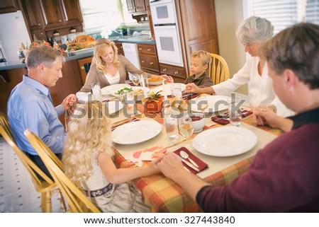 Thanksgiving: Family Has Blessing Before Thanksgiving Dinner - stock photo