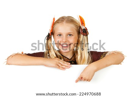 Thanksgiving: Indian Girl Points Down To Copyspace - stock photo
