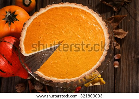 Thanksgiving pumpkin pie on a wooden table