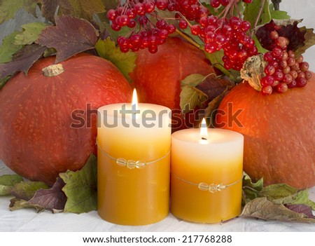Thanksgiving still life, pumpkins with burning candles - stock photo