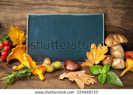 Thanksgiving still life with mushrooms, seasonal fruit and vegetables on wooden table with space for text.  Cooking concept - stock photo