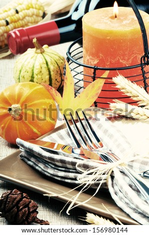 Thanksgiving table setting with pumpkins  - stock photo