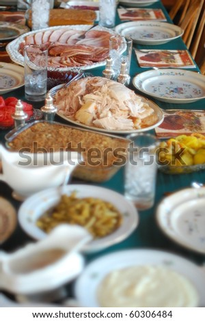Thanksgiving table with turkey, ham, gravy Mashed potatoes and all the fixings. - stock photo