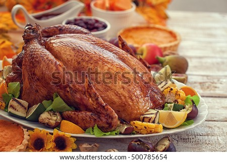 Thanksgiving Turkey dinner on white wooden table with copy space