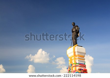 Thao Suranaree or Khun Ying Mo, wife of King Rama III who save the city from  invasion of the Laotian army, statue against blue sky at Korat, Thailand. - stock photo