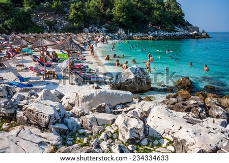 THASSOS, GREECE - AUGUST 14, 2010: Tourists of the marble beach on the beautiful coast with pristine beaches and turquoise waters photographed on August 14, 2010 on Thassos (or Thasos) Island, Greece.