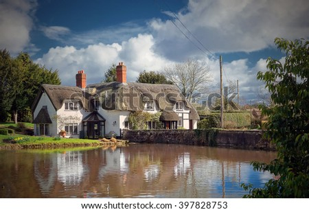 Thatched cottages behind duck pond in the idyllic English Village of Badger in Shropshire.