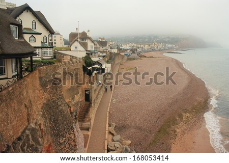 thatched houses above Sidmouth beach - stock photo