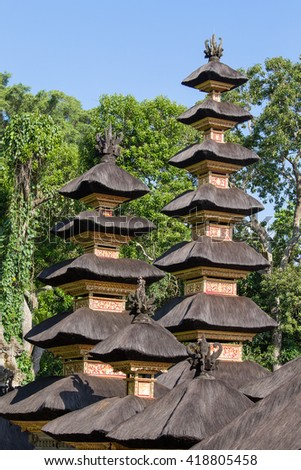 Thatched roof Hindu temple in city Ubud, Bali, Indonesia . Close up - stock photo