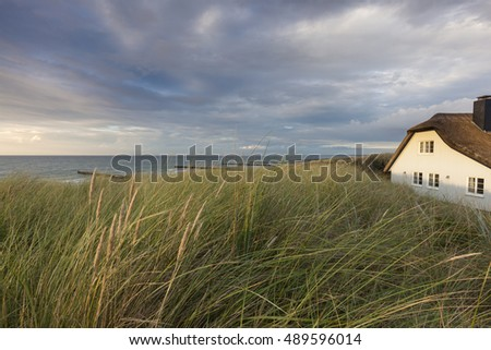 thatched roof house near Ahrenshoop on the baltic sea, germany