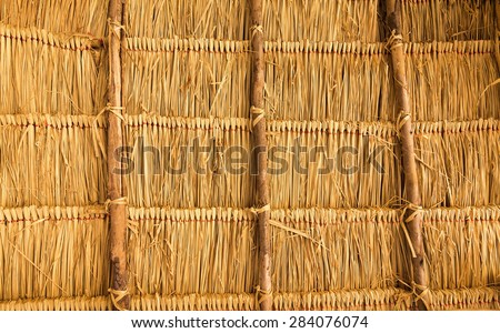 Thatched roof on the wood frame.Show background.Used film filter. - stock photo
