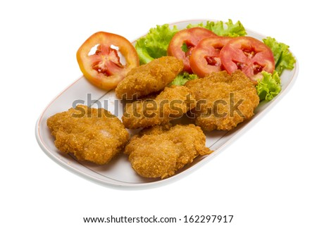 Thau Cutlet with tomatoes and salad
