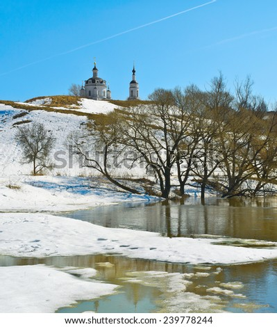 Thawing of snow in spring. Luzha river at Nikolsky Chernoostrovsky Convent in Malojaroslavets. Kaluga region of Russia - stock photo